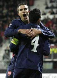 Robin van Persie and Cesc celebrate
