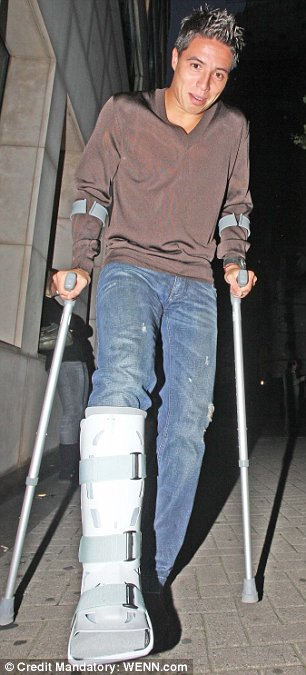 Samir Nasri on crutches