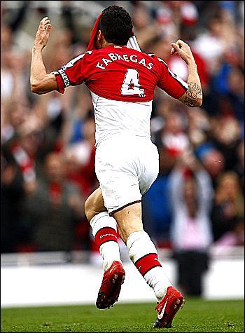 Cesc Fabregas celebrates v Tottenham
